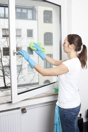 Woman cleaning a window photo