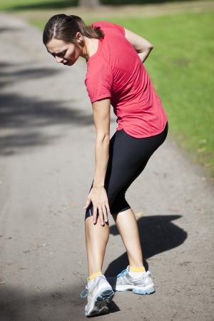 woman having cramp while running