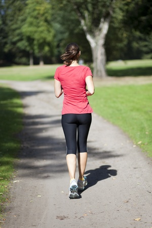 jogging track: woman running in a park