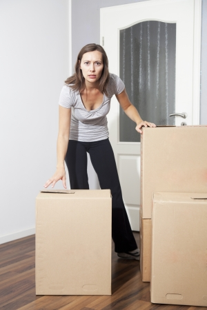 Woman moving house photo
