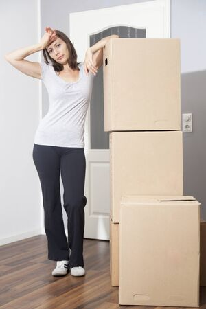 Woman tired of moving house photo