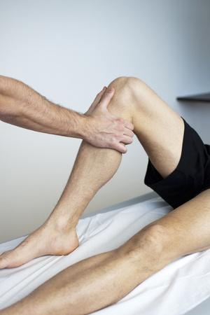 osteopathy: massage therapist working Stock Photo