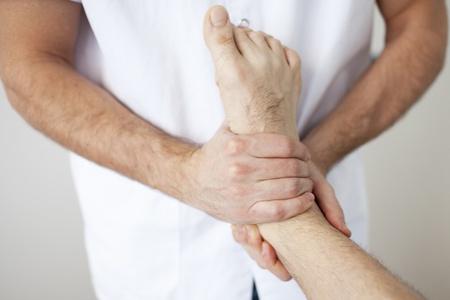 myofascial: massage therapist working Stock Photo