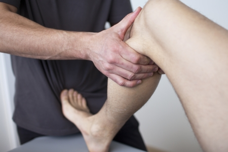 physical training: massage therapist working Stock Photo