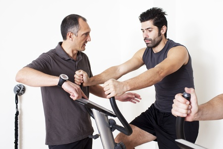 Physiotherapist helping patient with exercise photo