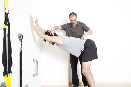 physical therapist: stretching Stock Photo