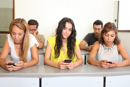Students with smart phones in class photo