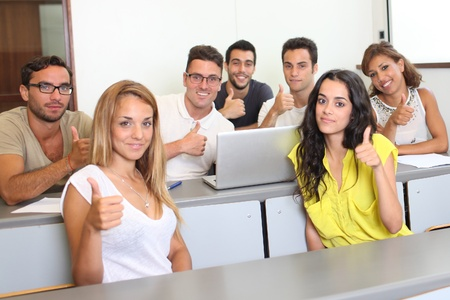 Students holding thumbs up in the university photo