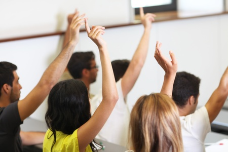 come up to: Students put hands up Stock Photo
