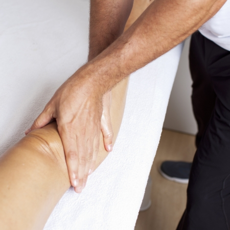 recuperating: physical therapist with patient Stock Photo