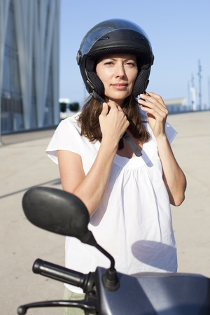 Attractive woman on a scooter photo