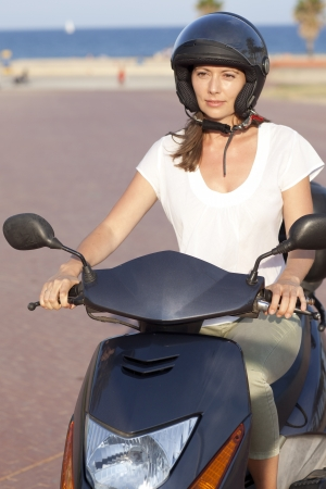 Attractive woman on a scooter