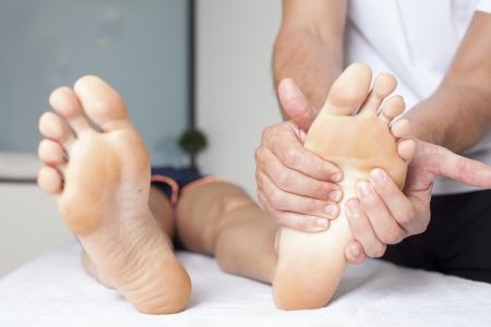Human hands massaging a woman's foot Stock Photo - 23365127