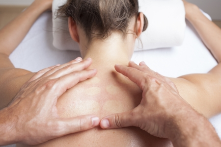 osteopathy: Chiropractor exercising female myofascial therapy