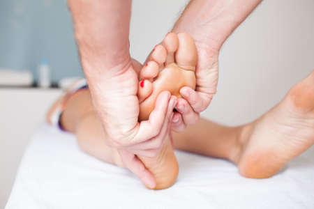 massaging a woman�s foot photo