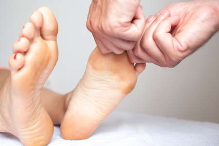 massaging a woman�s foot photo