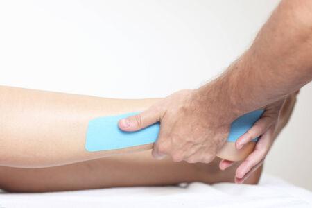 strenuous: Physio tape on leg