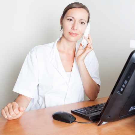 doctor appointment: receptionist making a phone appointment