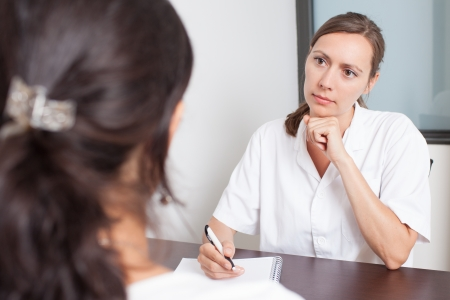Voir un gynécologue Banque d'images