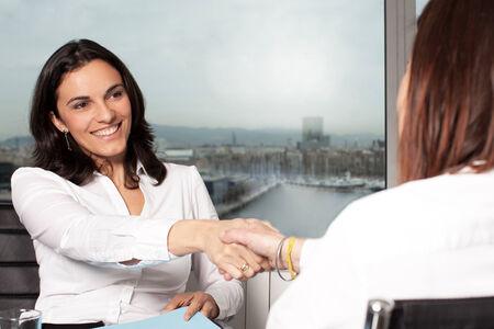 board room: Handshake in board room Stock Photo