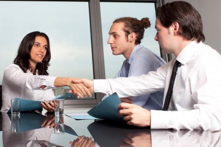 Handshake in board room photo