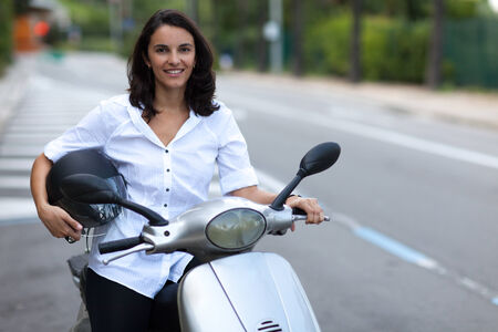 motor cycle: Woman on scooter