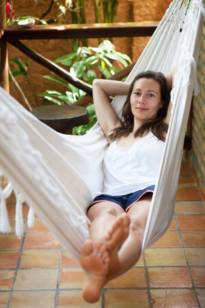 women relaxing during holidays in a hammock photo