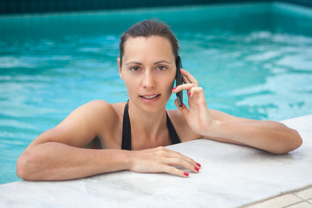 Woman calling from holidays photo