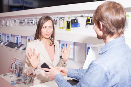 insist: Shop assistant dismissing customers complains about warranty