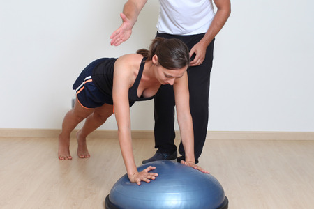 physical therapist: Balance training with physical therapist Stock Photo