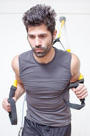 muscular man making suspension training Stock Photo