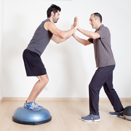 both sides: Balance training with physical therapist Stock Photo