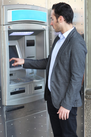 pincode: Man at the ATM Stock Photo