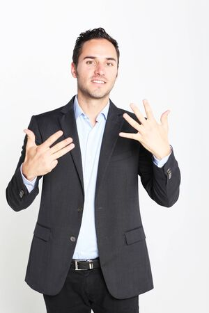 counting: Businessman counting number 9 Stock Photo
