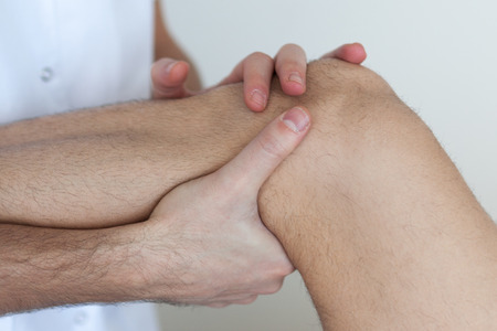 stimulus: knee massage Stock Photo