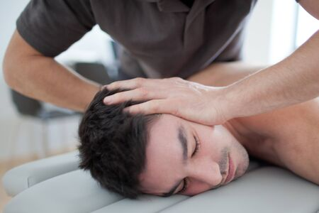 spinal column: Doctor adjusting the spinal column Stock Photo