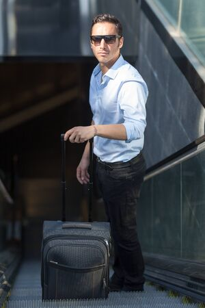 business traveller: Man with luggage