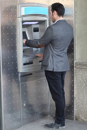 atm: Businessman at the ATM