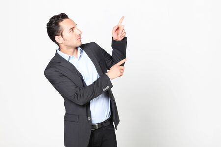 right on: man pointing to his left Stock Photo
