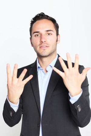 10: Businessman counting number 10 Stock Photo