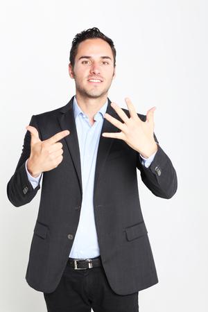 number seven: Businessman counting number seven