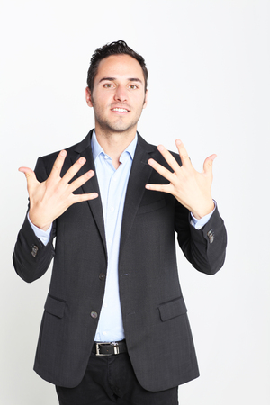 number 10: Businessman counting number 10 Stock Photo