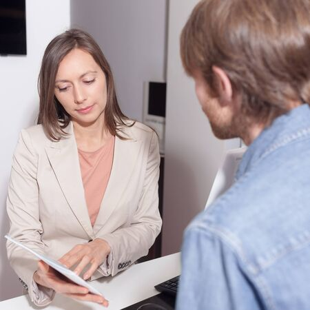 Salesperson checking a contract