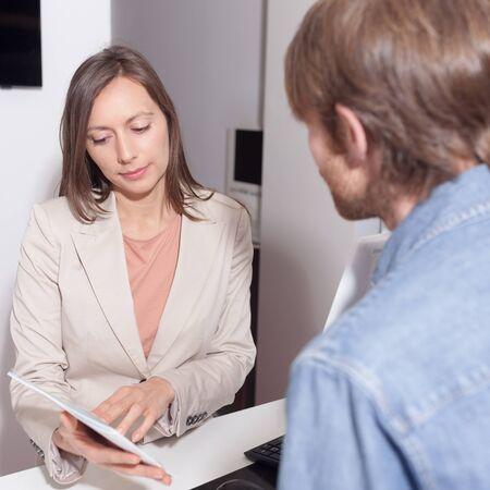 salesperson: Salesperson checking a contract