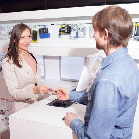 costumer: Saleswoman in shop with costumer