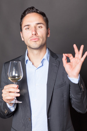specialize: Somelier approving a glass of white wine