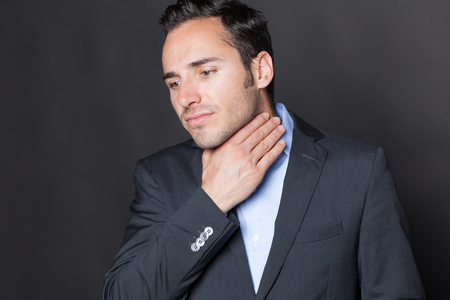 Businessman suffering from throat problems photo