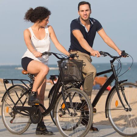 Tourists with rented bikes photo