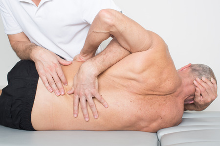 osteopathy: physiotherapy with an elder patient
