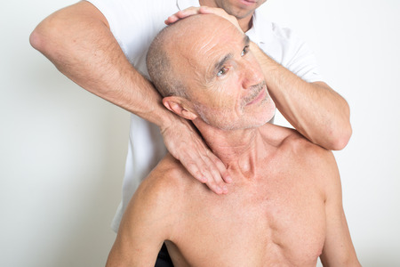 grey haired: Spinal manipulation